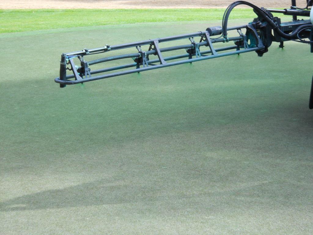 Closeup of applying the Endurant turf colorant using St. James Plantation's existing spraying equipment.